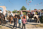 Children watch as hundreds of Mexican cowboys arrive to camp at a village stop along the road during the annual Cabalgata de Cristo Rey pilgrimage January 4, 2017 in La Sauceda, Guanajuato, Mexico. Thousands of Mexican cowboys and horse take part in the three-day ride to the mountaintop shrine of Cristo Rey stopping along the way at shrines and churches.