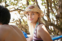 Young woman in sun hat outdoors head and shoulders