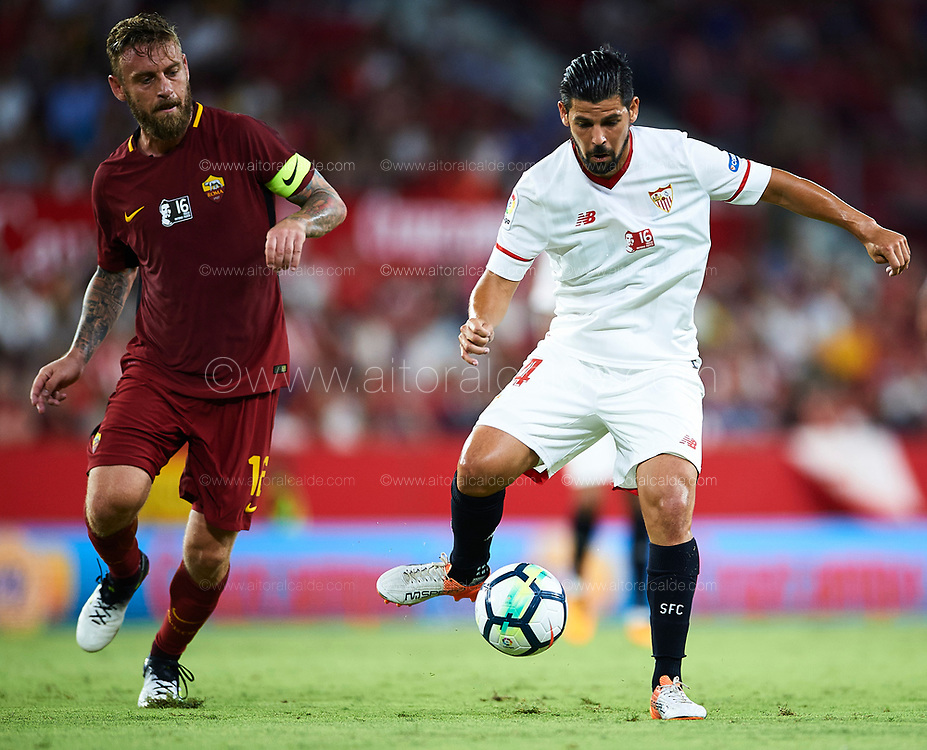 "SEVILLE, SPAIN - AUGUST 10:  Manuel Agudo ""Nolito"" of Sevilla FC (R) being followed by Daniele De Rossi of AS Roma (L)  during a Pre Season Friendly match between Sevilla FC and AS Roma at Estadio Ramon Sanchez Pizjuan on August 10, 2017 in Seville, Spain.  (Photo by Aitor Alcalde/Getty Images)"
