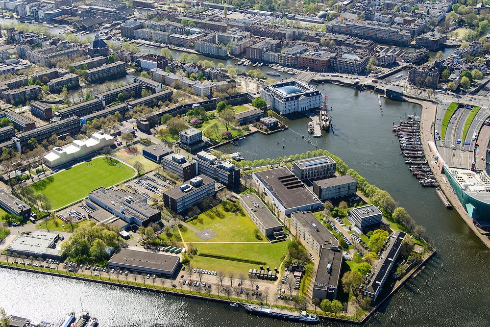 Nederland, Noord-Holland, Amsterdam, 09-04-2014;<br /> Het Marineterrein, Kattenburg en het Scheepvaartmuseum, rechts de IJtunnel en museum Nemo met historische woonboten. <br /> Navy area and the National Maritime Museum (white building), right Museum Nemo.<br /> luchtfoto (toeslag op standard tarieven);<br /> aerial photo (additional fee required);<br /> copyright foto/photo Siebe Swart