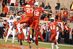 21 September 2013:  Anthony Warrum returns a punt for a touchdown and celebrates in the end zone with Josh Burch as the horn blows signaling the end of the first half during an NCAA football game between the Abilene Christian Wildcats and the Illinois State Redbirds at Hancock Stadium in Normal IL