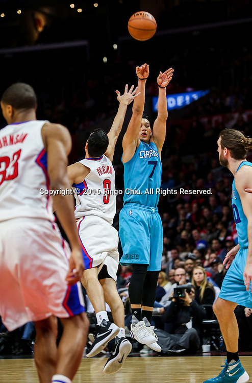 Charlotte Hornets Jeremy Lin shoots against Los Angeles Clippers Pablo Prigioni during the NBA basketball game in Los Angeles, the United States, Jan. 9, 2016. Los Angeles Clippers won 97-83. (Xinhua/Zhao Hanrong)(Photo by Ringo Chiu/PHOTOFORMULA.com)<br /> <br /> Usage Notes: This content is intended for editorial use only. For other uses, additional clearances may be required.