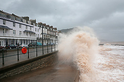 © Licensed to London News Pictures. 27/01/2016. Sidmouth, UK.  Waves batter the sea front at Sidmouth as the tail end of storm Jonas hits the UK. Photo credit: Peter Macdiarmid/LNP