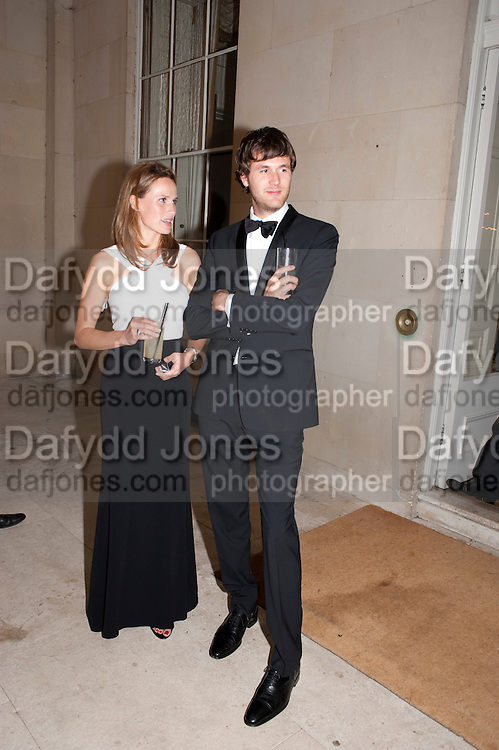 FRANCESCA CUMANI; ISAAC FERRY  The Goodwood Ball. In aid of Gt. Ormond St. hospital. Goodwood House. 27 July 2011. <br /> <br />  , -DO NOT ARCHIVE-© Copyright Photograph by Dafydd Jones. 248 Clapham Rd. London SW9 0PZ. Tel 0207 820 0771. www.dafjones.com.