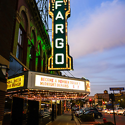 Photo of Fargo Theater at night along North Broadway Drive in downtown Fargo, North Dakota. The Fargo Theatre was built in 1926 and is on the National Register of Historic Places. The Fargo Theatre is currently a popular venue for films, movies, concerts, plays and other live events. Photo is vertical and was taken in 2011.
