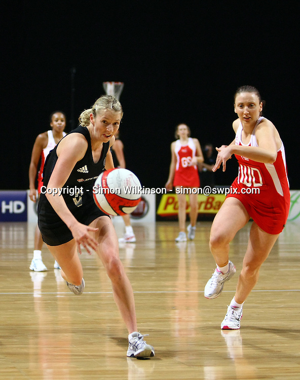 PICTURE BY VAUGHN RIDLEY/SWPIX.COM...Netball - International Netball Series - England v New Zealand - MEN Arena, Manchester, England - 15/01/11...New Zealand's Camilla Lees and England's Jade Clarke go after a loose ball.
