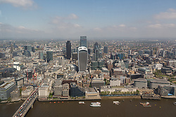 © Licensed to London News Pictures. 13/06/2016. LONDON, UK.  An aerial view of London showing the City of London skyline on the River Thames during sunny spring weather today. Haze and pollution is seen hanging towards the horizon.  Photo credit: Vickie Flores/LNP