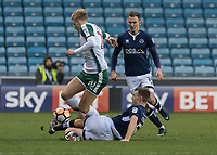 Football - 2017 / 2018 FA Cup - Third Round: Millwall vs. Barnsley<br /> <br /> Tony Craig (Millwall FC) slides in to intercept Brad Potts (Barnsley FC) and clear the ball at The Den.<br /> <br /> COLORSPORT/DANIEL BEARHAM