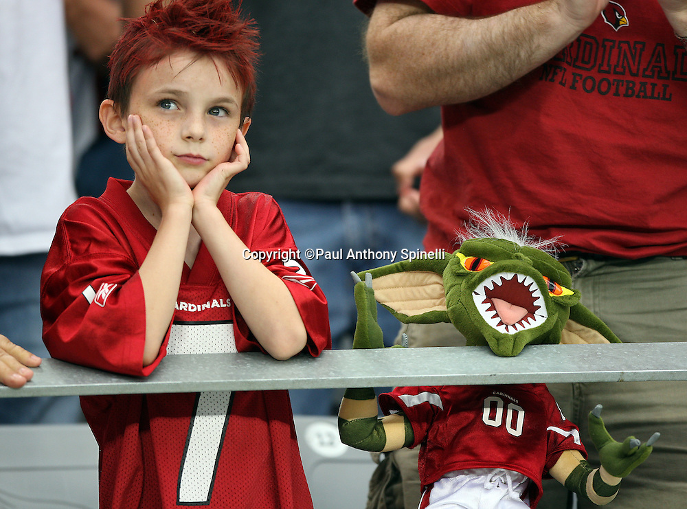 GLENDALE, AZ - OCTOBER 12: A fan of the Arizona Cardinals stands with his gremlin while both wearing team jerseys during the game against the Dallas Cowboys at University of Phoenix Stadium on October 12, 2008 in Glendale, Arizona. The Cardinals defeated the Cowboys 30-24 in overtime. ©Paul Anthony Spinelli