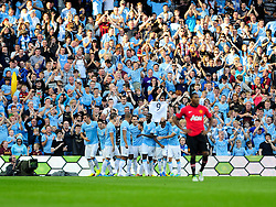 Manchester City's Sergio Aguero celebrates with his team mates after scoring. - Photo mandatory by-line: Dougie Allward/JMP - Tel: Mobile: 07966 386802 22/09/2013 - SPORT - FOOTBALL - City of Manchester Stadium - Manchester - Manchester City V Manchester United - Barclays Premier League