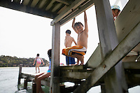 Children playing on pier