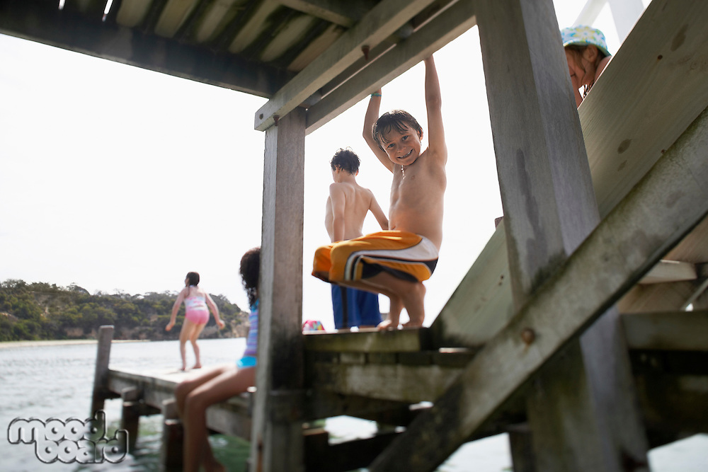 Children playing on pier