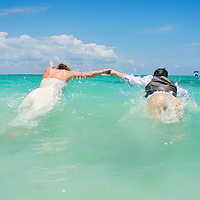 Dan and Casi take a dip in the Gulf of Mexico at Xpuha Beach on the Mayan Riviera after their wedding in Akumal, Mexico.