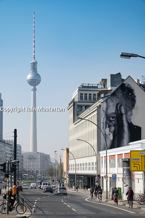 """JR"" mural on building wall and Television Tower in Berlin Germany"
