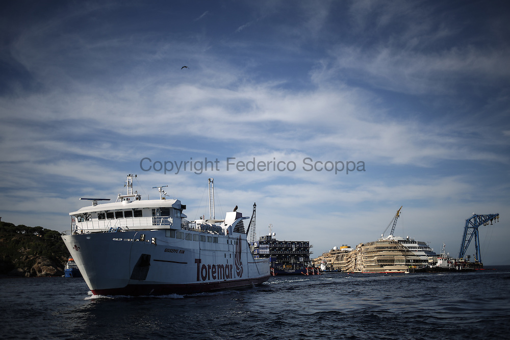 The Costa Concordia ship wreck seen from the Giglio Island port