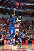 Louisville forward Montrezl Harrell has his shot contested Kentucky forward Marcus Lee in the second half. Kentucky won 58-50.<br /> <br /> The University of Louisville hosted the University of Kentucky, Saturday, Dec. 27, 2014 at The Yum Center in Louisville.
