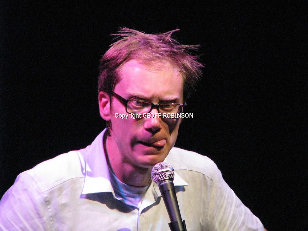 BAFTA  winning actor  and writer Stephen Merchant went back to his roots last night this week  by doing a low key  stand up show in Cambridge in front of 100 people...Merchant who co wrote the award winning series The Office and Extras with Ricky Gervais is playing a small number of shows  entitled 'Work In Progress' before launching a tour in larger venues...The one hour show at The Junction included sketches on Nerds joining Al Qaeda , the awkwardness of a  six  foot seven inch man have sex,and a dig at Ricky Gervais by saying at least on this tour he does not have to give half the money to him..