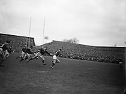 Irish forward M L Hipwell, on the right, in possession getting away from M J Campbell- Lamberton, Scottish forward,..Irish Rugby Football Union, Ireland v Scotland, Five Nations, Landsdowne Road, Dublin, Ireland, Saturday 24th February, 1962,.24.2.1962, 2.24.1962,..Referee- N M Parkes, Rugby Football Union, ..Score- Ireland 6 - 20 Scotland, ..Irish Team, ..F G Gilpin, Wearing number 15 Irish jersey, Full Back, Queens University Rugby Football Club, Belfast, Northern Ireland,..W R Hunter, Wearing number 14 Irish jersey, Right Wing, C I Y M S Rugby Football Club, Belfast, Northern Ireland, ..M K Flynn, Wearing number 13 Irish jersey, Right Centre, Wanderers Rugby Football Club, Dublin, Ireland, ..D Hewitt, Wearing number 12 Irish jersey, Left centre, Instonians Rugby Football Club, Belfast, Northern Ireland,..N H Brophy, Wearing number 11 Irish jersey, Left wing, Blackrock College Rugby Football Club, Dublin, Ireland, ..G G Hardy, Wearing  Number 10 Irish jersey, Stand Off, Bective Rangers Rugby Football Club, Dublin, Ireland,  ..J T M Quirke, Wearing number 9 Irish jersey, Scrum Centre, Blackrock College Rugby Football Club, Dublin, Ireland, ..S Millar, Wearing number 1 Irish jersey, Forward, Ballymena Rugby Football Club, Antrim, Northern Ireland,..A R Dawson, Wearing number 2 Irish jersey, Forward, Wanderers Rugby Football Club, Dublin, Ireland, ..R J McLoughlin, Wearing number 3 Irish jersey, Forward, University College Dublin Rugby Football Club, Dublin, Ireland, ..W A Mulcahy, Wearing number 4 Irish jersey, Captain of the Irish team, Forward, Bohemians Rugby Football Club, Limerick, Ireland,..W J McBride, Wearing number 5 Irish jersey, Forward, Ballymena Rugby Football Club, Antrim, Northern Ireland,..D Scott, Wearing number 6 Irish jersey, Forward, Malone Rugby Football Club, Belfast, Northern Ireland, ..M L Hipwell, Wearing number 8 Irish jersey, Forward, Terenure Rugby Football Club, Dublin, Ireland, ..M G Culliton, Wearing number 7 Irish jersey, Forward, Wan