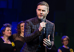 "© Licensed to London News Pictures . 12/01/2016 . Salford , UK . GARY BARLOW makes a surprise appearance and performs in front of the audience at the Lowry Theatre , during the opening week of "" The Girls "" , a musical he wrote based on the story "" Calendar Girls "" , about a group of Women's Institute members in Yorkshire , who made a nude calendar . Photo credit : Joel Goodman/LNP"