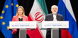 14.07.2015, Austria Center, Wien, AUT, Einigung bei E3/ EU+3 - Iran Gespraeche (Frankreich, Deutschland, Vereinigtes Koenigreich, China, Russland und USA), im Bild v.l.n.r. EU- Außenbeauftragte Federica Mogherini und der iranische Außenminister Mohammad Javad Zarif // f.l.t.r. High Representative of the European Union for Foreign Affairs and Security Policy Federica Mogherini and Foreign Minister of Iran Javad Zarif during aggreement of P5+1 - Iran Talks (France, Germany, United Kingdom, China, Russia and USA) at Austria Centre in Vienna, Austria on 2015/07/14, EXPA Pictures © 2015, PhotoCredit: EXPA/ Michael Gruber