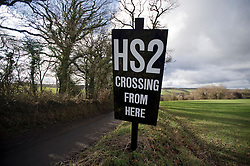 © Licensed to London News Pictures. 27/01/2012. Wendover, UK. An anti HS2 (High Speed Rail 2) sign showing the planned route of HS2 rail in the countryside of Buckinghamshire, near Wendover. Scheduled to be completed by 2033, the new Rail system will have huge effects on the local countryside. Photo credit : Ben Cawthra/LNP