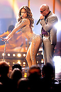 LOS ANGELES, CA - NOVEMBER 20:  Singer Jennifer Lopez and rapper Pitbull perform onstage at the 2011 American Music Awards at Nokia Theatre L.A. Live on November 20, 2011 in Los Angeles, California.  (Photo by Joe Kohen/WireImage)