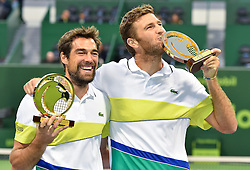 Jeremy Chardy (L) and Fabrice Martin (R) of France pose with the trophy after winning the ATP Qatar Open Tennis tournament doubles final against Vasek Pospisil of Canada and Radek Stepanek of Czech Republic at the Khalifa International Tennis Complex in Doha, capital of Qatar, on January 06, 2017. Jeremy Chardy and his teammate Fabrice Martin became won the title 2-0. (Credit Image: © Nikku/Xinhua via ZUMA Wire)