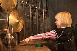 United States, Washington, Bellevue, girl (age 5) at water exhibit at KidsQuest Children's Museum.  MR, PR