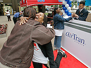 Charlotte McDuffie hugs Charlotte Hogan after receiving a free round-trip ticket on AirTran Airways, Friday, June 9, 2006 in Chicago. To mark new non-stop service from Chicago's Midway Airport to Dallas/Fort Worth and Charlotte, NC, AirTran Airways gave away free airline tickets to people named Charlotte or Dallas. (For Airtran)