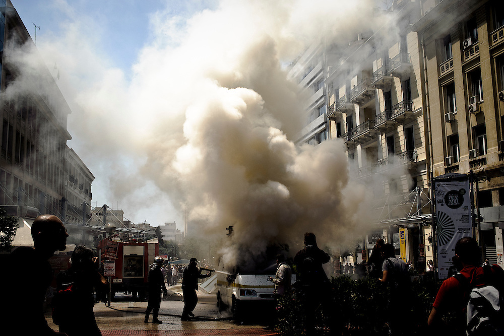 May 1st 2010, protesters burn a vehicle of ERT (Greek public television) during May Day demonstrations in Athens, Greece.