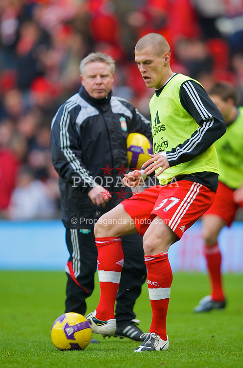 LIVERPOOL, ENGLAND - Sunday, February 1, 2009: Liverpool's Martin Skrtel warms up with assistant manager Sammy Lee before his side's Premiership match against Chelsea at Anfield. (Mandatory credit: David Rawcliffe/Propaganda)