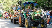Grand marshals Martina and Andy Howe work their way through Gilford Village driven by Tammy Seed for the annual Old Home Day parade Saturday morning.  (Karen Bobotas/for the Laconia Daily Sun)
