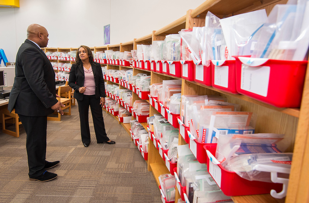 Tarrieck Rideaux, left, shows the leveled library to HISD Board of Education President Rhonda Skillern-Jones, right, during a dedication ceremony at Dogan Elementary School on September 29, 2014.