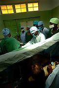 Bujumbura November 28, 2005 - Prince Regent Charles Hospital. It is one of Burundi's most reference medical facilities. Surgeon with medical student ©Jean-Michel Clajot