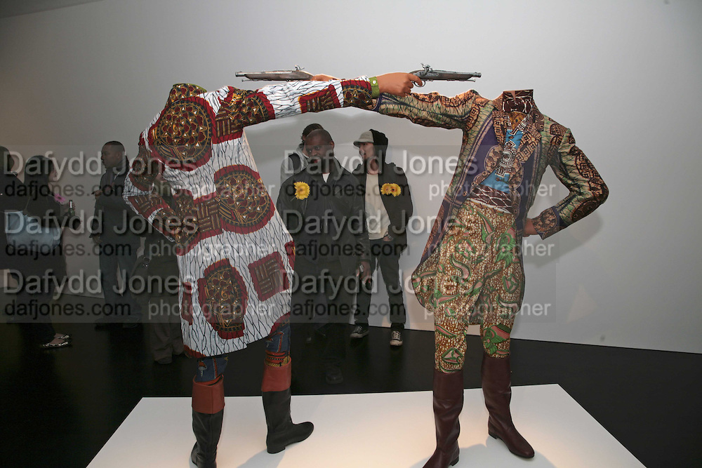 Yinka Shonibare MBE, Flower Time. Private view at the Stephen Friedman Gallery.  Old Burlington St.  London 30 November 2006.   ONE TIME USE ONLY - DO NOT ARCHIVE  © Copyright Photograph by Dafydd Jones 248 CLAPHAM PARK RD. LONDON SW90PZ.  Tel 020 7733 0108 www.dafjones.com