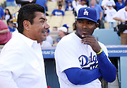 LOS ANGELES, CA - APRIL 6:  (L-R) Actor and comedian George Lopez talks to Yasiel Puig #66 of the Los Angeles Dodgers before the game against the San Francisco Giants at Dodger Stadium on Sunday, April 6, 2014 in Los Angeles, California. The Dodgers won the game 6-2. (Photo by Paul Spinelli/MLB Photos via Getty Images) *** Local Caption *** George Lopez;Yasiel Puig
