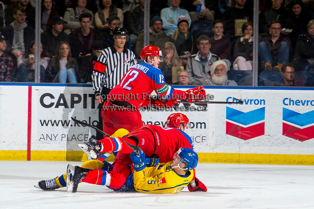 KELOWNA, BC - DECEMBER 18: Adam Ginning #5 of Team Sweden falls to the ice after a check by Makar Khabarov #22 of Team Russia at Prospera Place on December 18, 2018 in Kelowna, Canada. (Photo by Marissa Baecker/Getty Images)***Local Caption***
