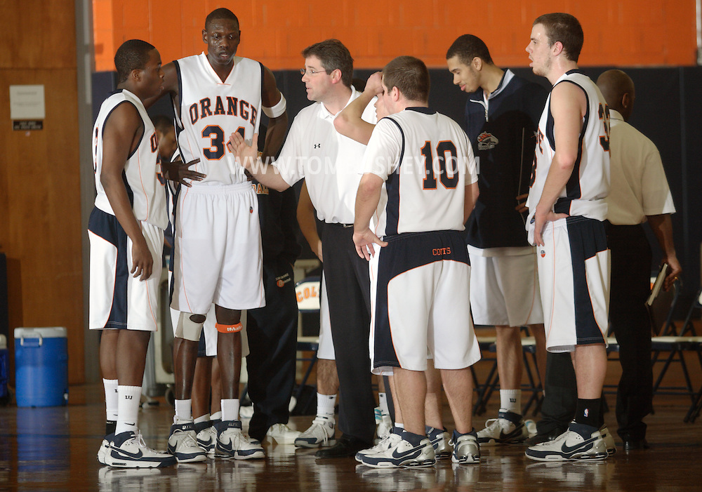 Middletown, NY - SUNY Orange men's basketball coach Thomas Rickard talks to his team during a timeout in a Mid-Hudson Conference game against Rockland Community College in Middletown on Feb. 26, 2008.