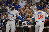 Aug 11, 2017; Phoenix, AZ, USA; Chicago Cubs infielder Ben Zobrist (18) is congratulated by infielder Ben Zobrist (18) after scoring against the Arizona Diamondbacks in the first inning at Chase Field. Mandatory Credit: Jennifer Stewart-USA TODAY Sports