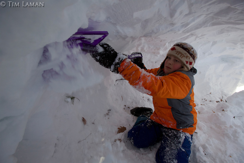 Russell Laman (age 12) digging a snow cave in the backyard after a massive blizzard hit the northeast.