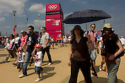 Spectators walk past a large welcoming gateway sign in the Olympic Park during the London 2012 Olympics. This land was transformed to become a 2.5 Sq Km sporting complex, once industrial businesses and now the venue of eight venues including the main arena, Aquatics Centre and Velodrome plus the athletes' Olympic Village. After the Olympics, the park is to be known as Queen Elizabeth Olympic Park.