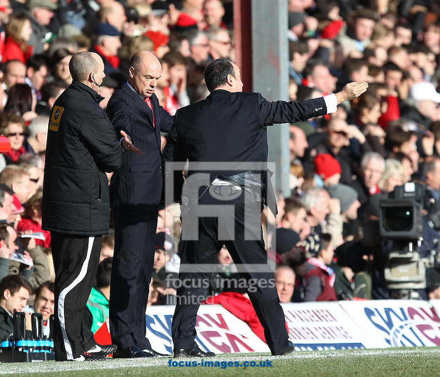 Picture by John  Rainford/Focus Images Ltd +44 7506 538356.27/01/2013.Uwe Rosler of Brentford complains to fourth official Mike Dean the Rafa Benitez of Chelsea is encroaching into his technical area during the The FA Cup match at Griffin Park, London.