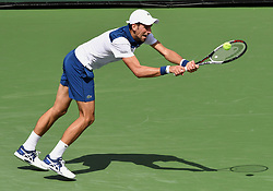 March 11, 2018 - Indian Wells, CA, U.S. - INDIAN WELLS, CA - MARCH 11: Novak Djokovic (SRB) dives to return the ball in the second set of a match played at the BNP Paribas Open on March 11, 2018 at the Indian Wells Tennis Garden in Indian Wells, CA. (Photo by John Cordes/Icon Sportswire) (Credit Image: © John Cordes/Icon SMI via ZUMA Press)