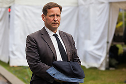 "London, UK. 25 September, 2019. Ed Vaizey, Independent MP for Didcot and Wantage, is interviewed on College Green on the day after the Supreme Court ruled that the Prime Minister's decision to suspend parliament was ""unlawful, void and of no effect"". Credit: Mark Kerrison/Alamy Live News"