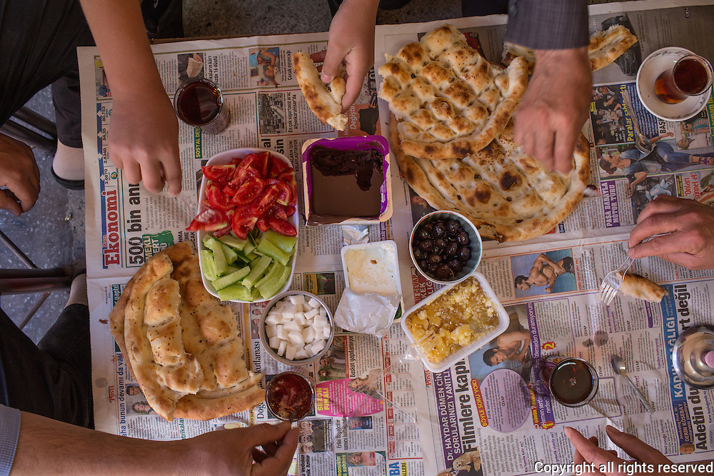 Tea shop owner's breakfast. Butter with honey, olives, chocolate spread, tomato, cucumber, whtie cheese, pide. Van, Turkey