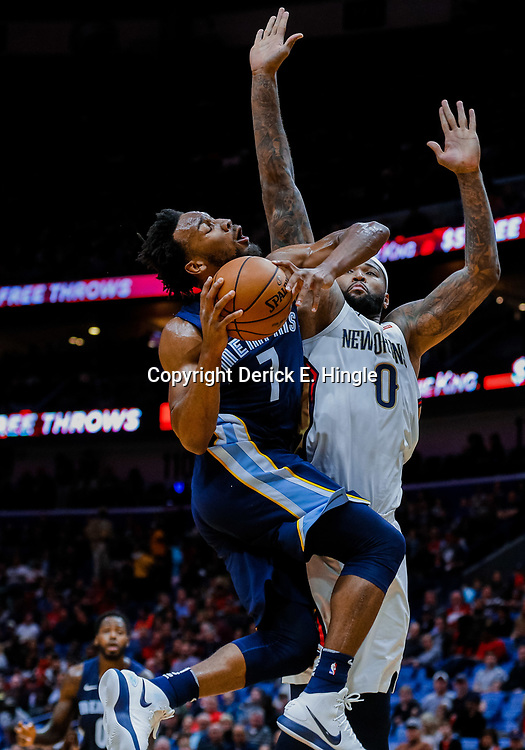 Jan 20, 2018; New Orleans, LA, USA; Memphis Grizzlies guard Wayne Selden (7) is called with a charging foul as New Orleans Pelicans center DeMarcus Cousins (0) defends during the first half at the Smoothie King Center. Mandatory Credit: Derick E. Hingle-USA TODAY Sports