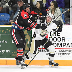TRENTON, ON - Apr 22, 2016 -  Ontario Junior Hockey League game action between the against the Trenton Golden Hawks and the Georgetown Raiders. Game 5 of the Buckland Cup Championship Series, at the Duncan Memorial Gardens in Trenton, Ontario. Jonathan Hampton #40 of the Georgetown Raiders battles for control with Jordan DaSilva #24 of the Trenton Golden Hawks during the first period.<br /> (Photo by Andy Corneau / OJHL Images)