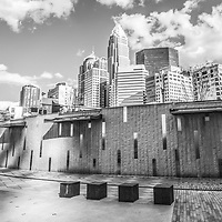 Charlotte North Carolina panorama black and white photo at Romare Bearden Park with clouds. Panorama phot ratio is 1:3. Includes One Wells Fargo Center, Two Wells Fargo Center, Bank of America Corporate Center, Bank of America Plaza, 121 West Trade building, The Vue, and Carillon Tower. Charlotte, North Carolina is a major city in the Eastern United States of America
