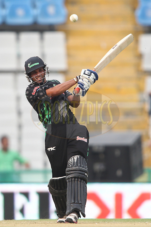 Keshav Maharaj of the Dolphins hits over the top during match 4 of the Oppo Champions League Twenty20 between the Dolphins and the Perth Scorchers held at the Punjab Cricket Association Stadium, Mohali, India on the 20th September 2014<br /> <br /> Photo by:  Shaun Roy / Sportzpics/ CLT20<br /> <br /> <br /> Image use is subject to the terms and conditions as laid out by the BCCI/ CLT20.  The terms and conditions can be downloaded here:<br /> <br /> http://sportzpics.photoshelter.com/gallery/CLT20-Image-Terms-and-Conditions-2014/G0000IfNJn535VPU/C0000QhhKadWcjYs