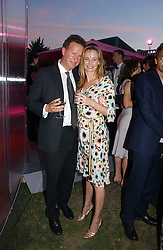 ORLANDO FRASER and CLEMENTINE HAMBRO at the Serpentine Gallery Summer party sponsored by Yves Saint Laurent held at the Serpentine Gallery, Kensington Gardens, London W2 on 11th July 2006.<br />